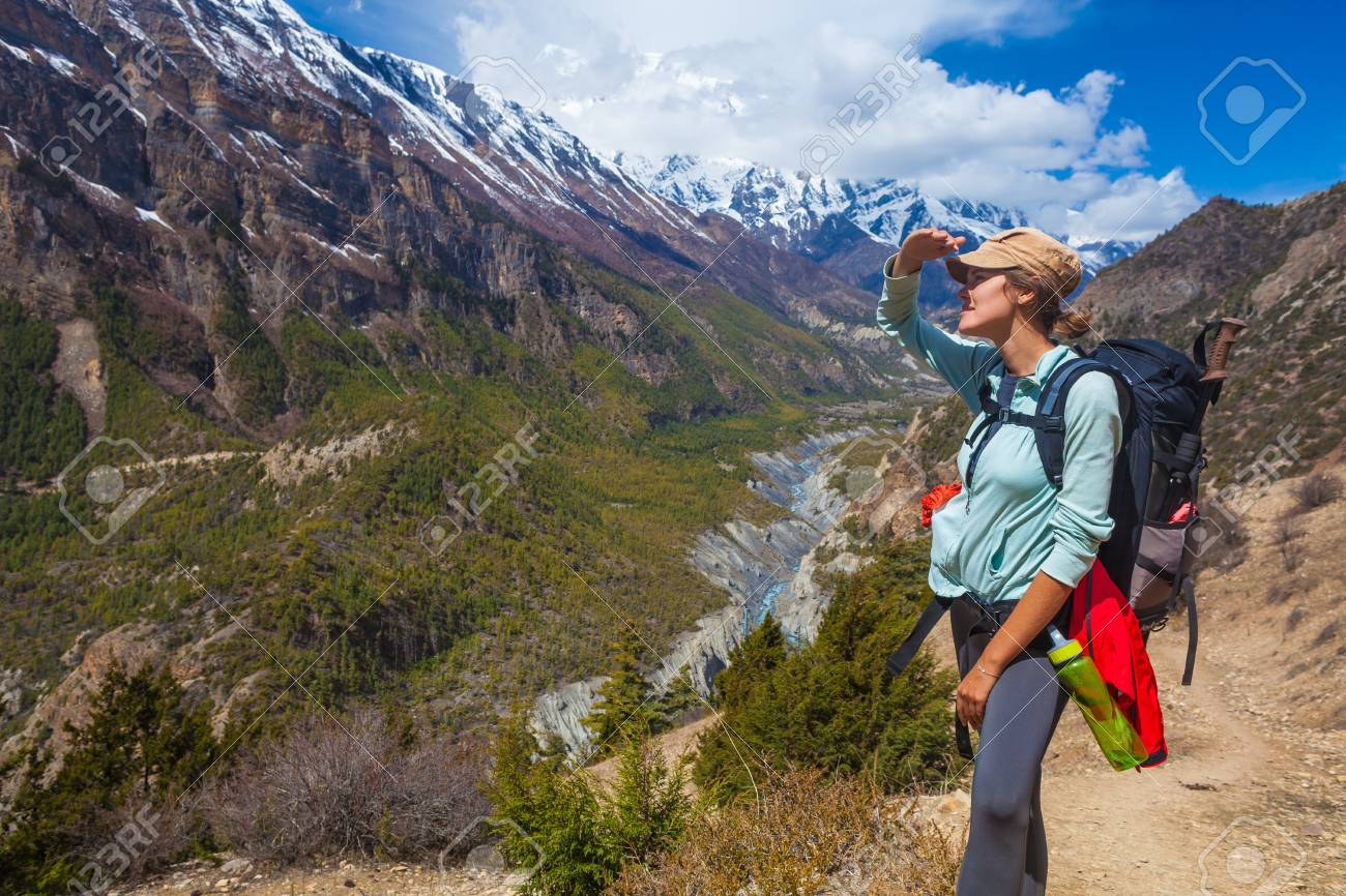 Closeup Beautiful Woman Traveler Backpacker Mountains Path.Young Girl Looks Horizon Take Rest.North Summer Snow Landscape Background. Horizontal Photo Stock Photo - 63727158