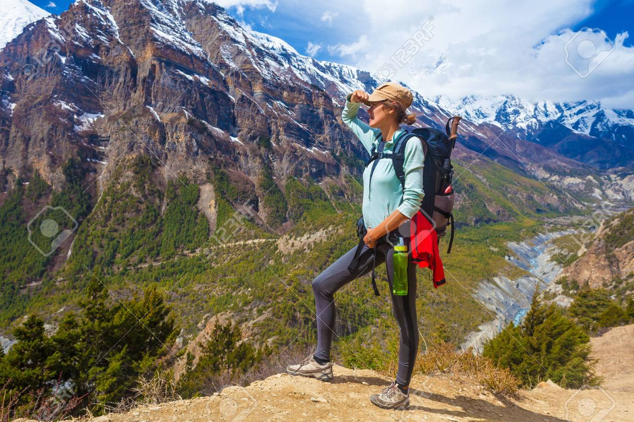 Beautiful Woman Traveler Backpacker Mountains Path.Young Girl Looking Right Way and Take Rest.North Summer Snow Landscape Background. Horizontal Photo Stock Photo - 63727161