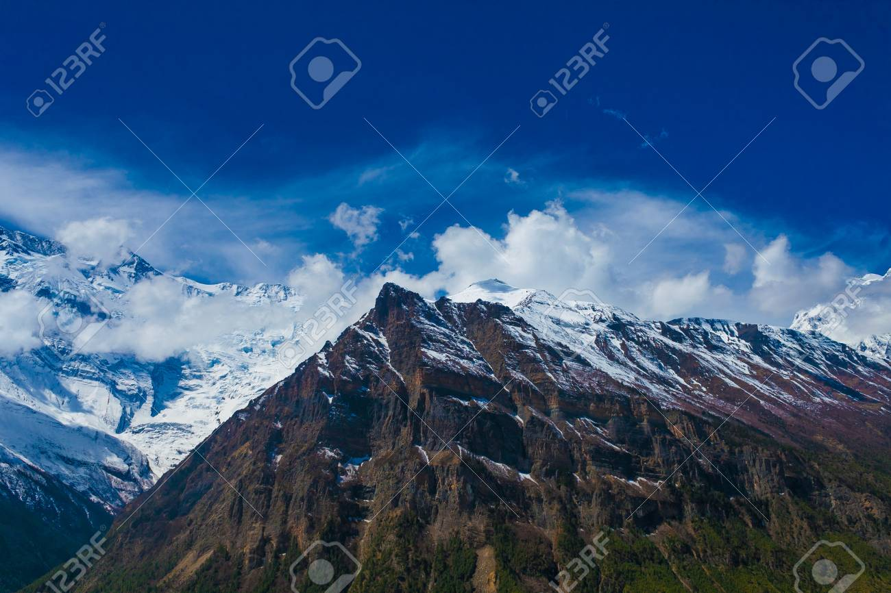 Landscape Snow Mountains Nature Viewpoint.Mountain Trekking Landscapes Background. Nobody photo.Asia Travel Hikking Sport Horizontal picture. Sunlights White Clouds Blue Sky. Himalayas Rocks Stock Photo - 63727209