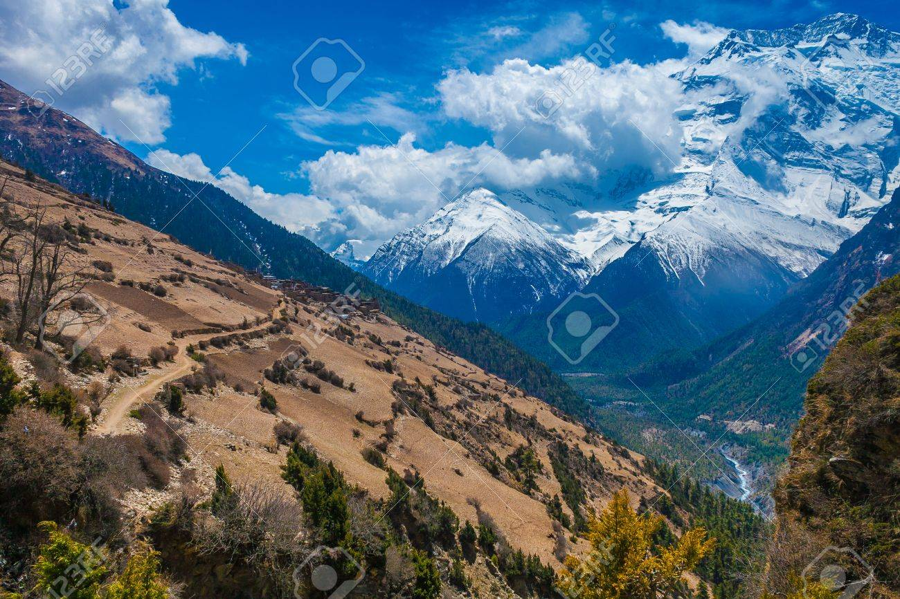 Beautiful Landscape View Snow Mountains Nature Viewpoint.Mountain Trekking Landscapes Background. Nobody photo.Asia Travel Sport.Horizontal picture. Sunlights White Clouds Blue Sky. Himalayas Rocks Stock Photo - 63727288