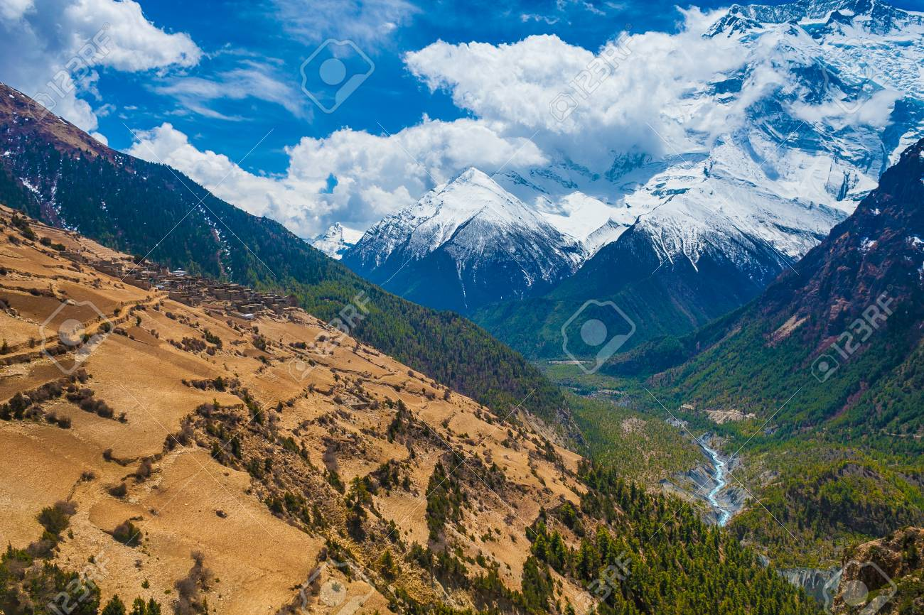 Beautiful Landscape View Snow Mountains Nature Viewpoint.Mountain Trekking Landscapes Background. Nobody photo.Asia Travel Sport.Horizontal picture. Sunlights White Clouds Blue Sky. Himalayas Way Stock Photo - 63727292