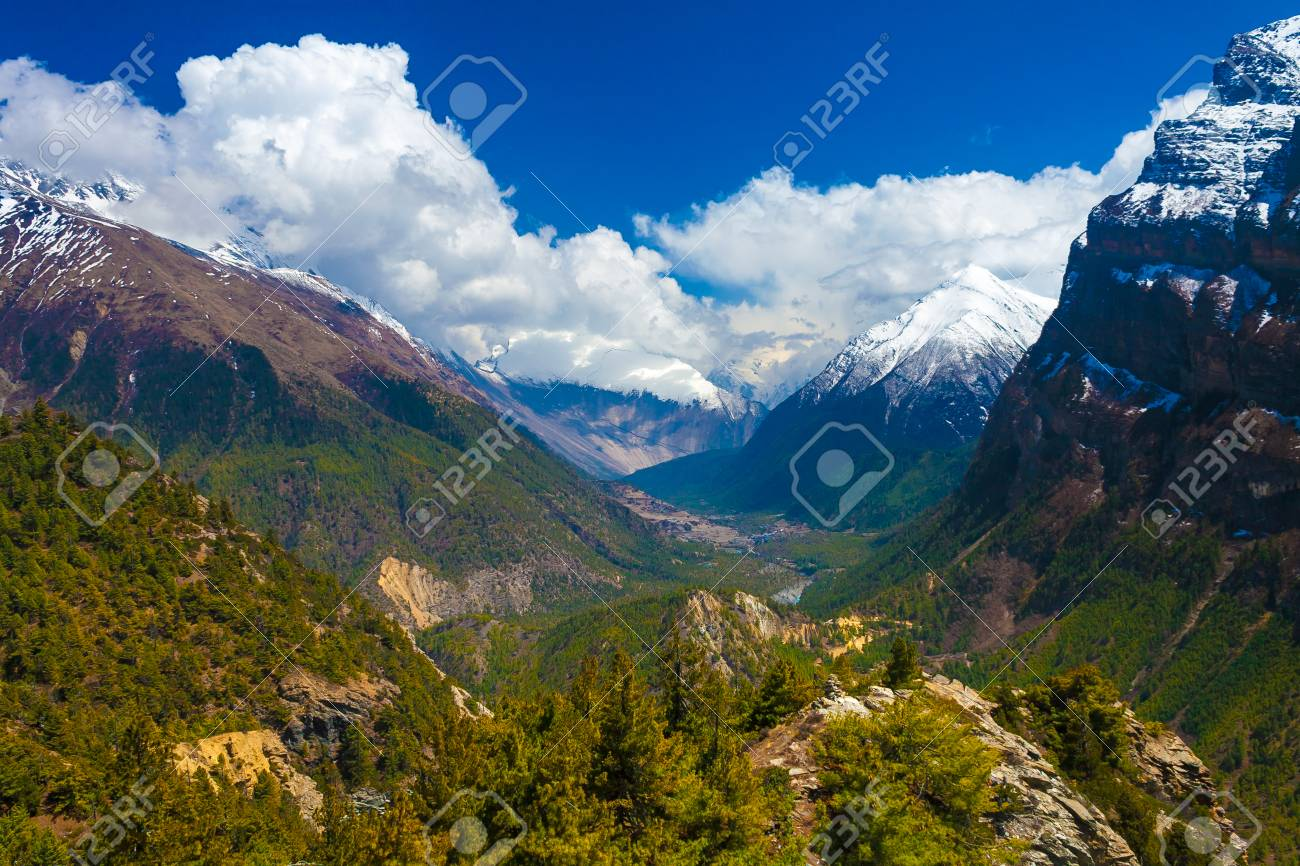 Landscape Snow Mountains Nature Viewpoint.Mountain Trekking Landscapes Background. Nobody photo.Asia Travel Horizontal picture. Sunlights White Clouds Blue Sky. Himalayas Hills Stock Photo - 63727296