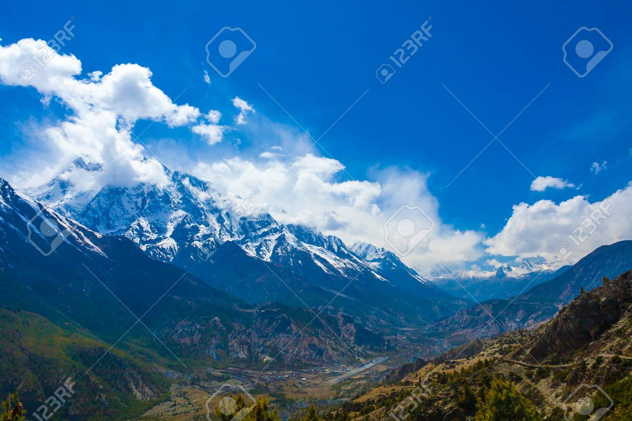 Landscape Snow Mountains Nature Viewpoint.Mountain Trekking Landscapes Background. Nobody photo.Asia Travel Horizontal image. Sunlights White Clouds Blue Sky. Himalayas Hills Stock Photo - 63727298
