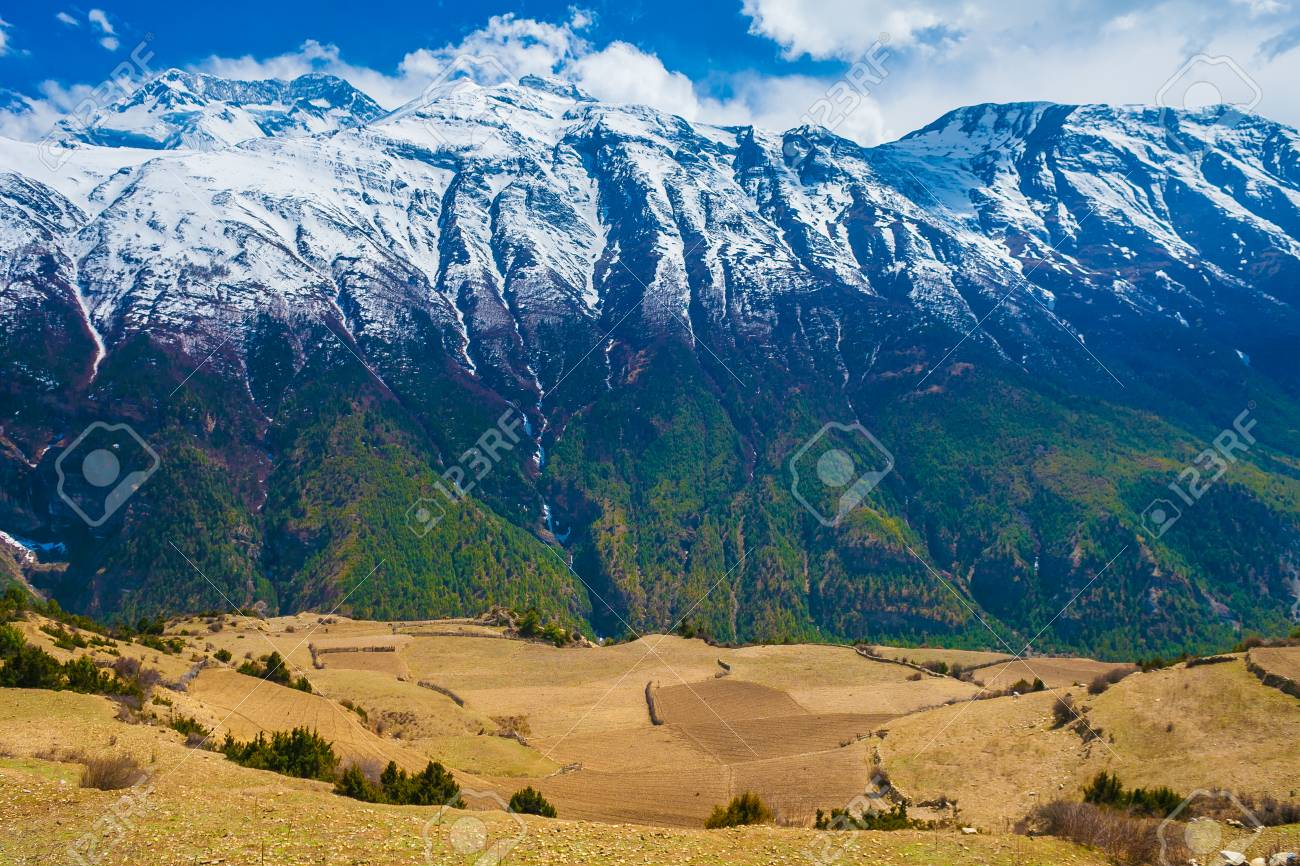 Landscape Snow Mountains Nature Viewpoint.Mountain Trekking Landscapes Background. Nobody photo.Asia Travel Horizontal picture. Sunlights White Clouds Blue Sky. Himalayas Hills Empty Fields Stock Photo - 63727300