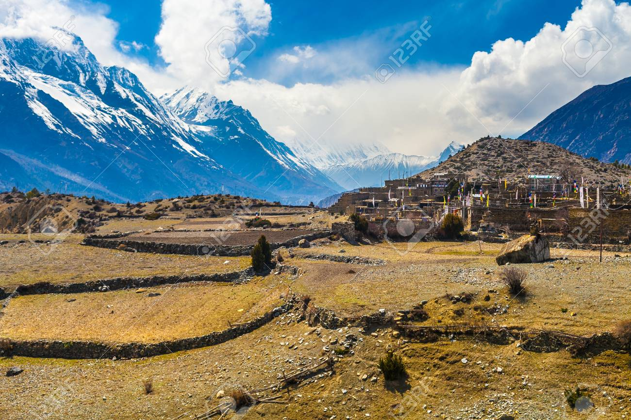 Landscape Snow Mountains Nature Nepal.Mountain Trekking Landscapes Background. Nobody photo.Asia Travel Horizontal picture. Sunlights White Clouds Blue Sky. Himalayas Hills Empty Terrace Stock Photo - 63727309