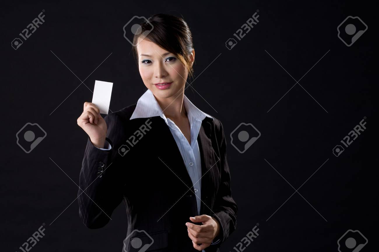 asian business woman with white card on black background Stock Photo - 2276142