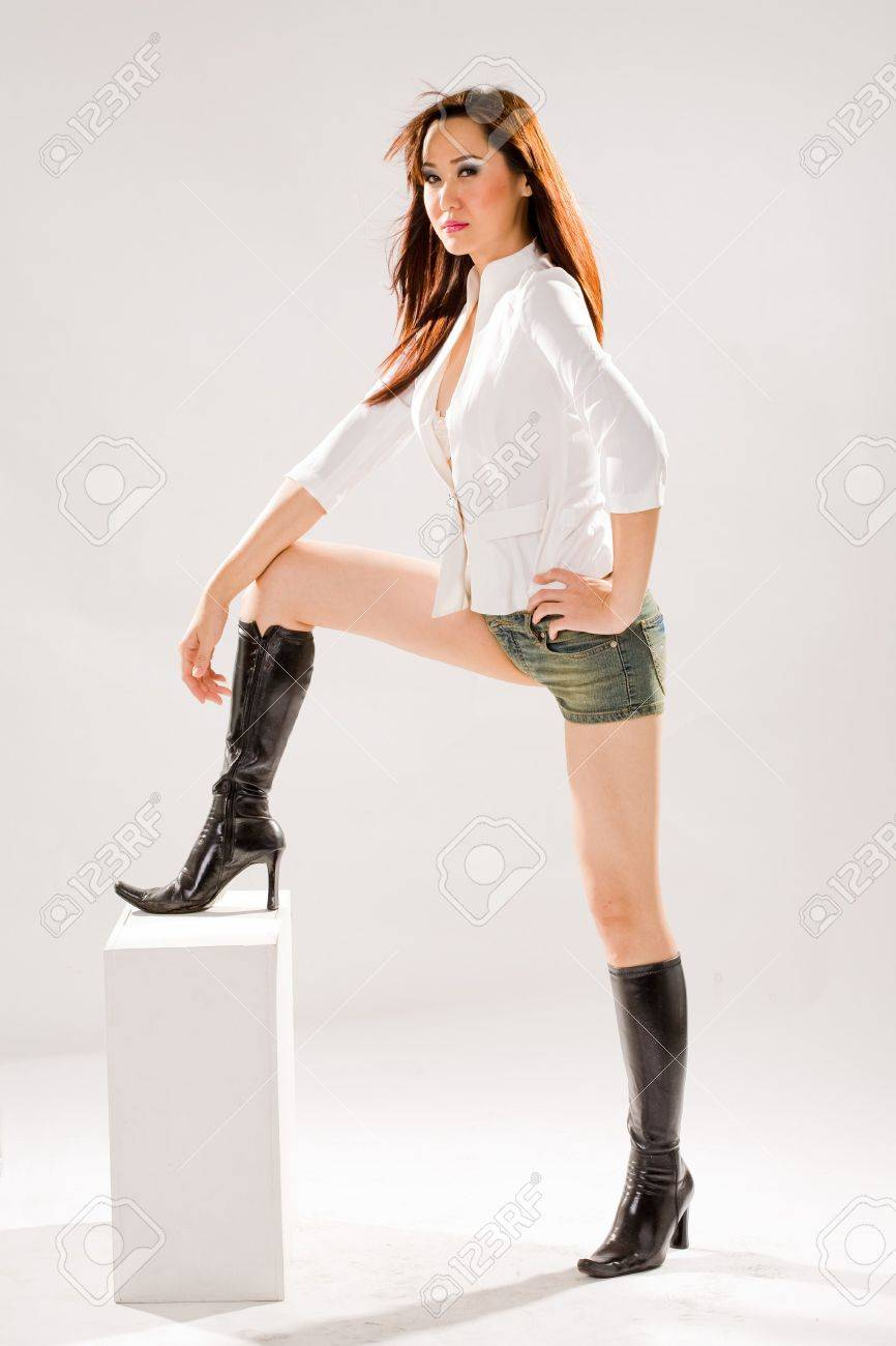 A Very Sexy Bold Woman In Tight Denim Shorts And High Boots Stock Photo 2610768