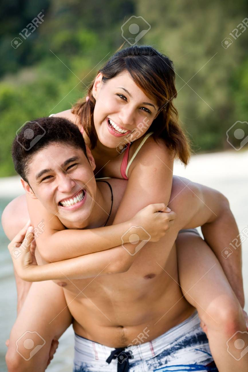 couple having fun at the beach by piggyback carrying Stock Photo - 2640726