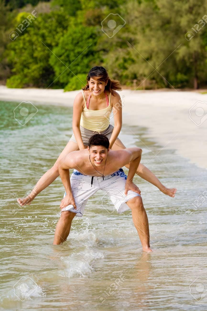 woman and man having fun hopping on the beach Stock Photo - 2680895