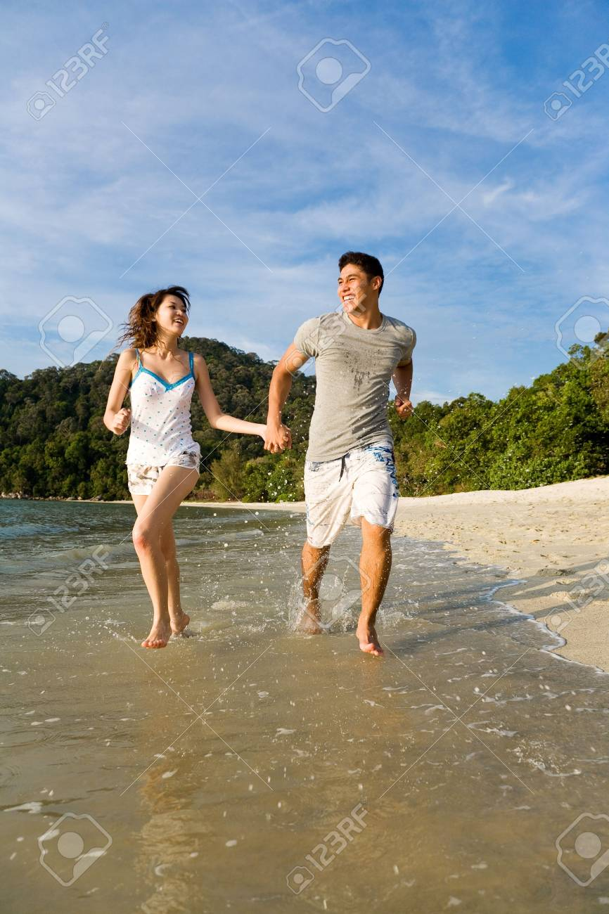 loving young couple running along the beach happilly Stock Photo - 2680899