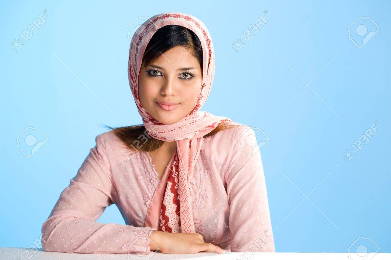 beautiful hamble young Muslim woman in head scarf and traditional wear Stock Photo - 3319324