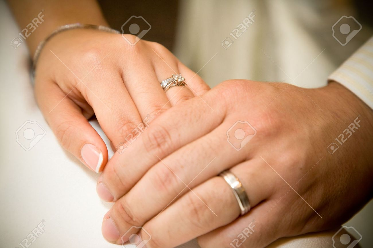 bride and groom holding hands with wedding rings on it stock photo - Wedding Rings On Hands
