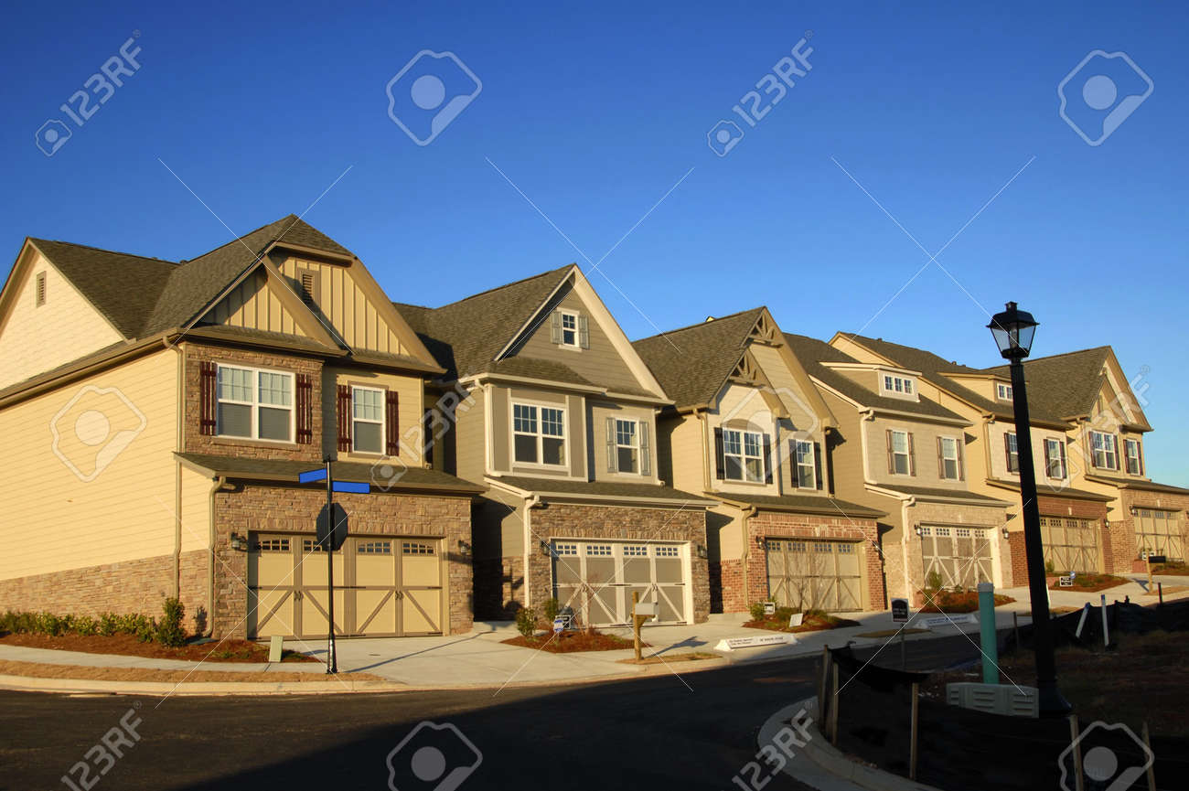 Early Morning Sunrise on New Townhouses Stock Photo - 2512615