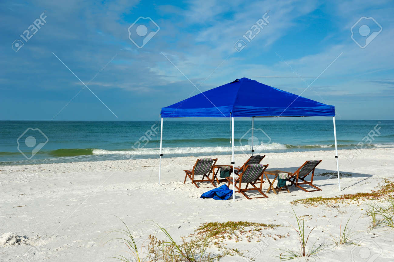 Beach lounge chair portable - Portable Shelter With Lounge Chairs And Tables Set Up On The Beach Stock Photo 33424254