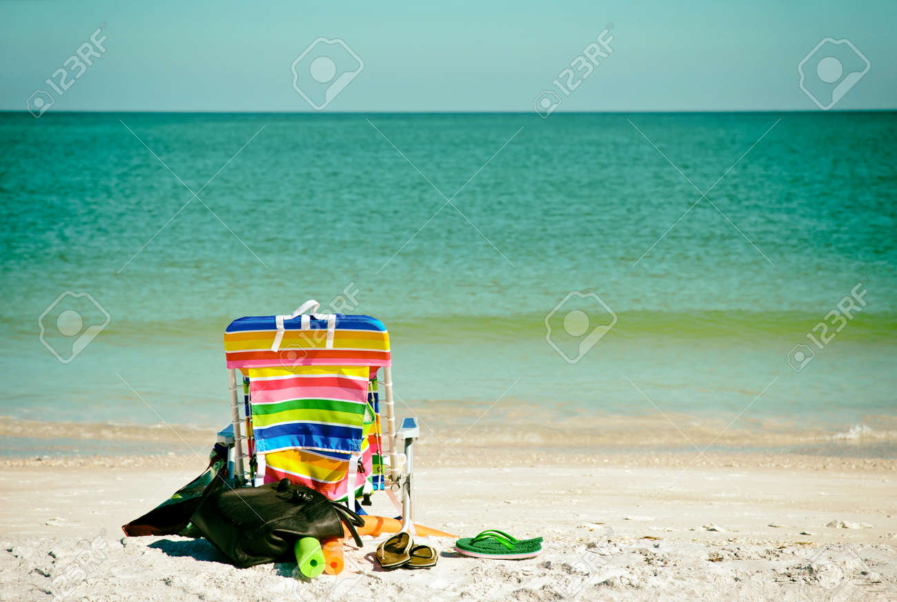 Flip Flop Chair Bright Color Beach Chair With Flip Flops Floats And Bag On The