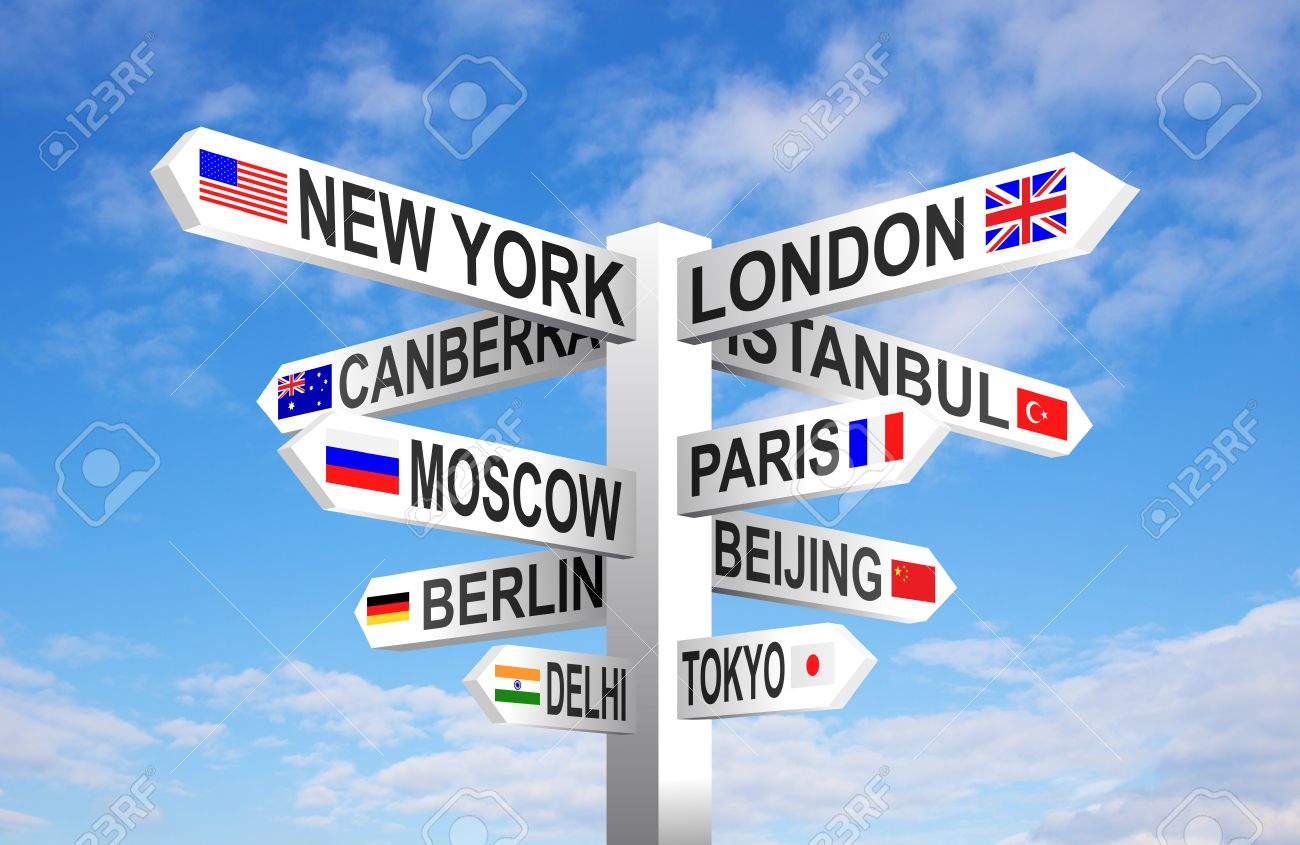 World capital cities and flags signpost against blue sky - 35484784