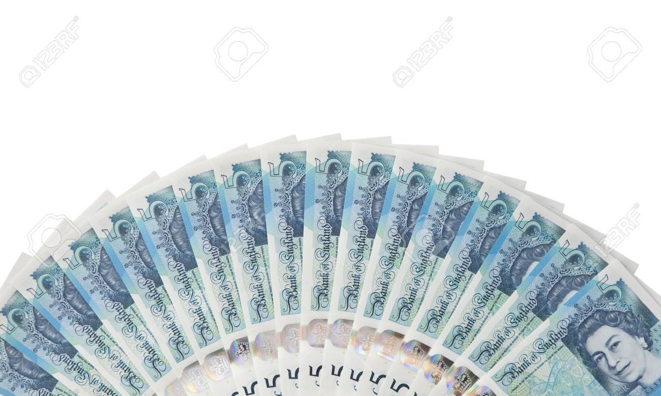 New English plastic five pound note fanned out isolated against white background - 70519564