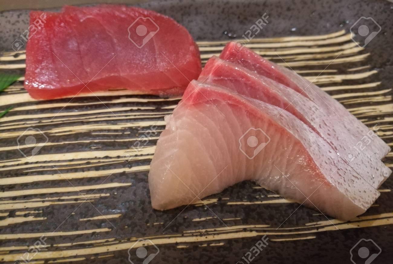 Fresh Japanese Hamachi White Raw Fish Sashimi With Tuna Slice Stock