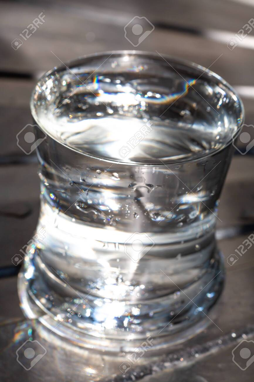 Glass Of Clean Water Water Drops Silver Metal Background Light