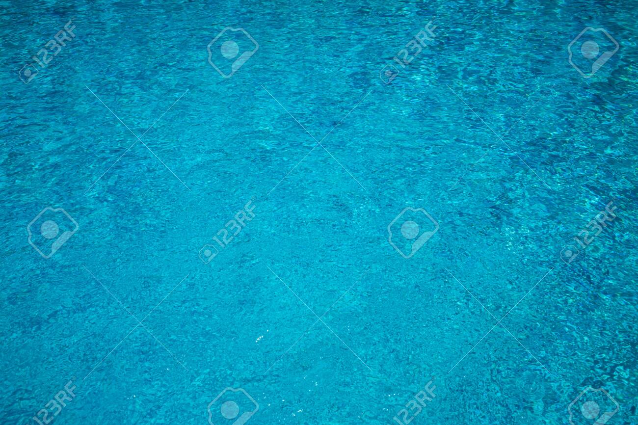Blue swimming pool with Bubble water texture background - 129765513