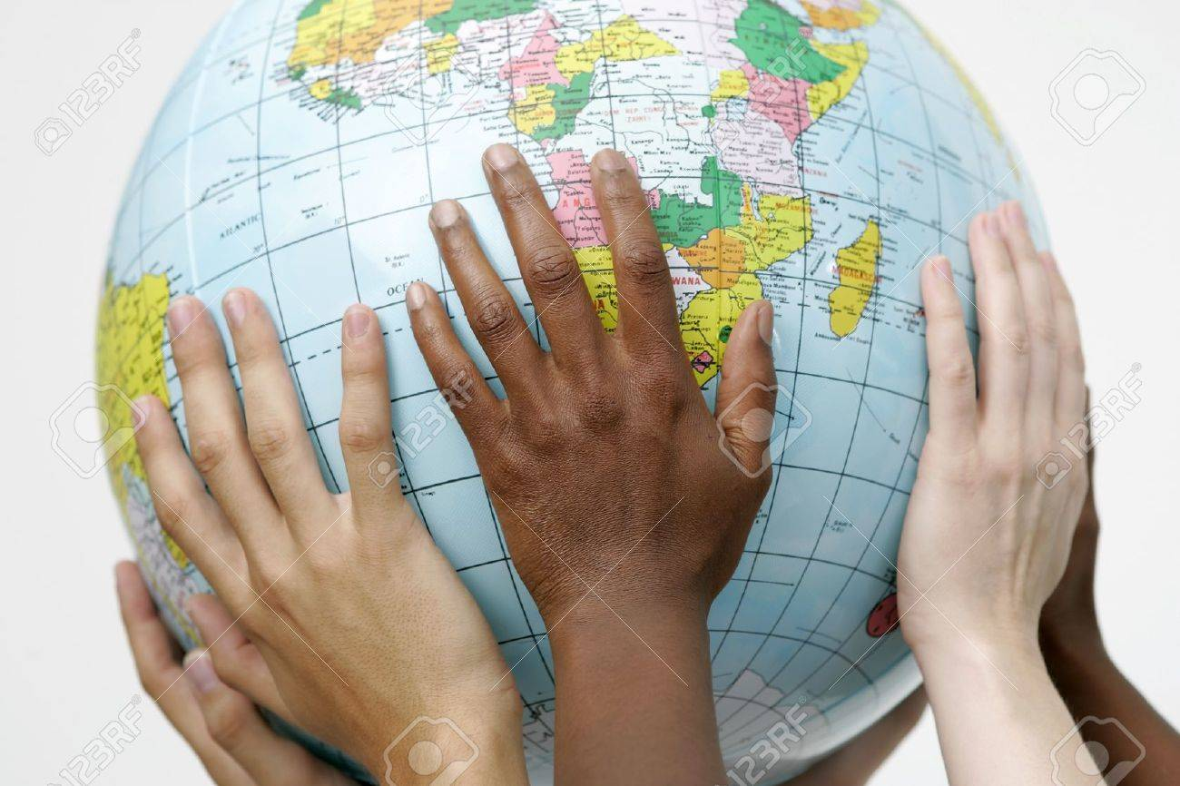 People holding up a globe Stock Photo - 8824378