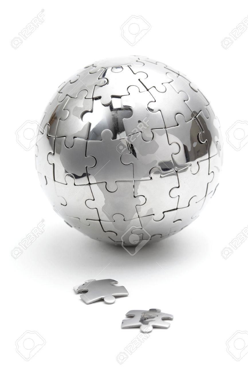 Metal puzzle globe isolated on white background - 8824442
