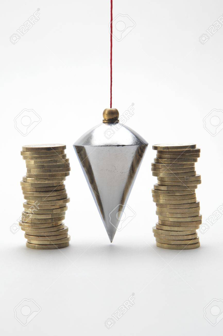 Plumb bob with coin stacks on white background Stock Photo - 9375171