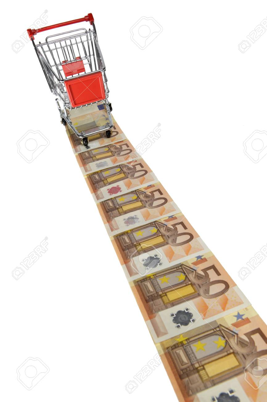 Mini shopping cart standing on a line of euro banknotes on white background Stock Photo - 9510327