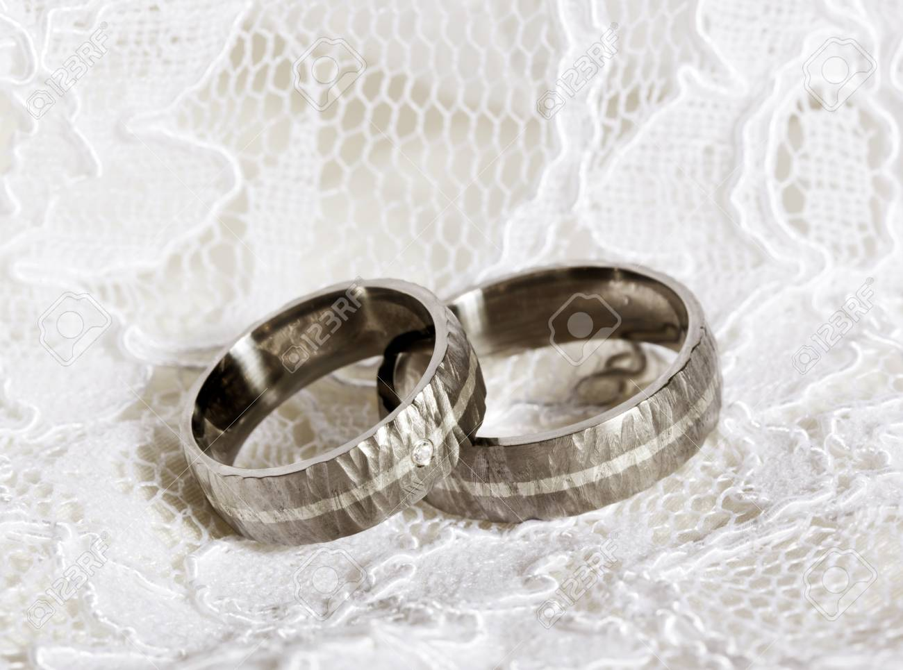 Pair Of Rustic Wedding Rings On White Lace Stock Photo Picture And