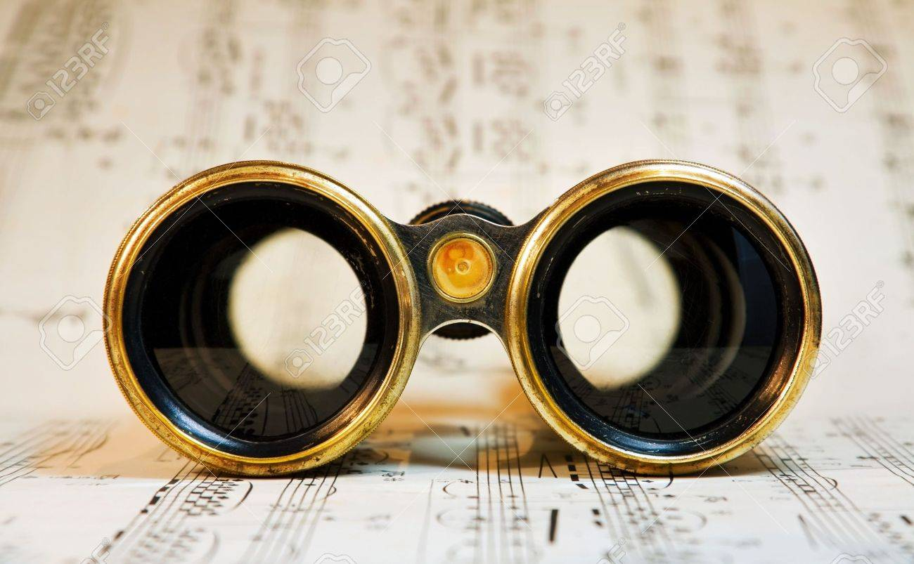 Old theater binoculars over classical music scores