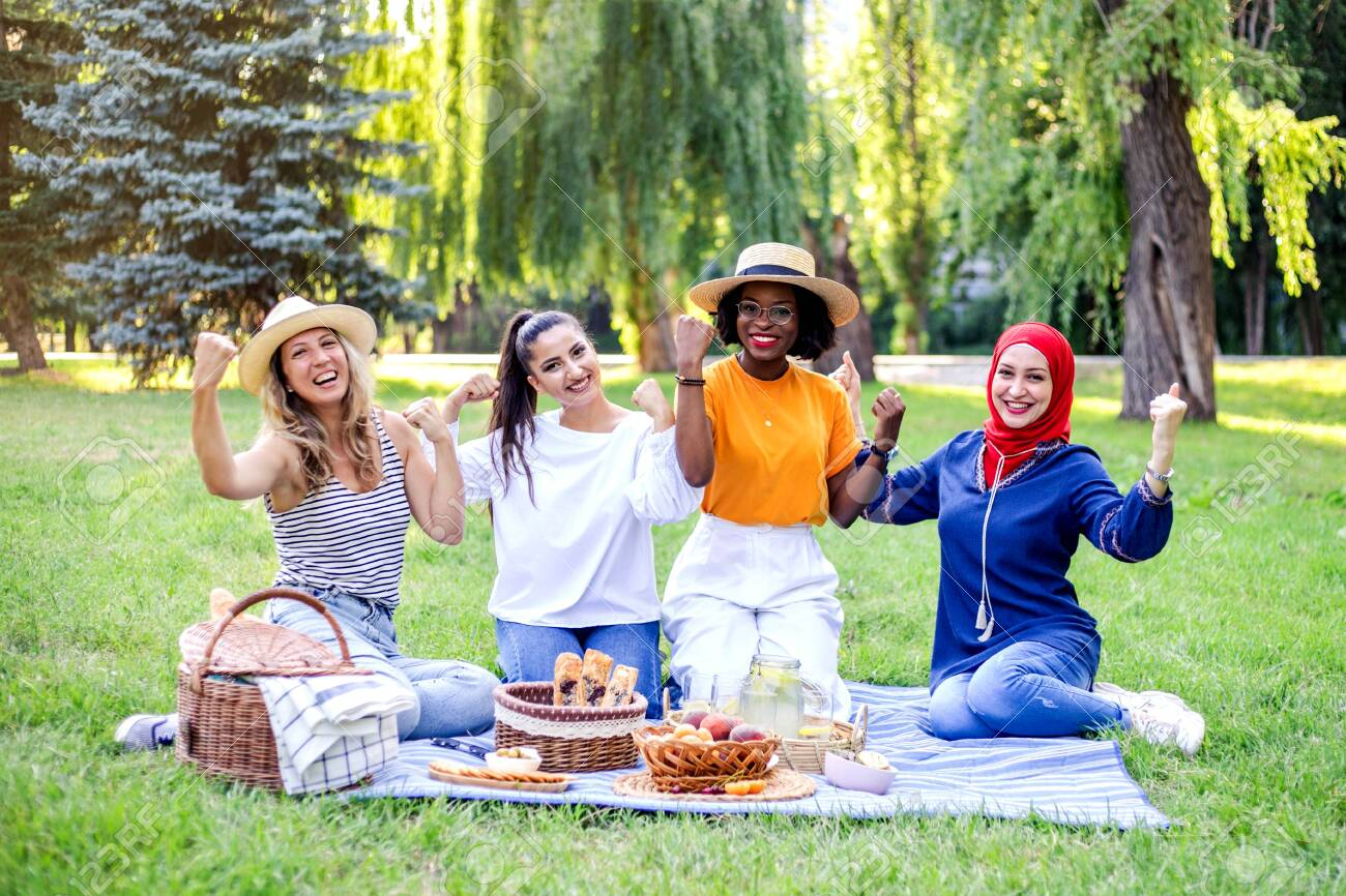 Young multiracial women are on picnic in the park. Womens power. - 153244626