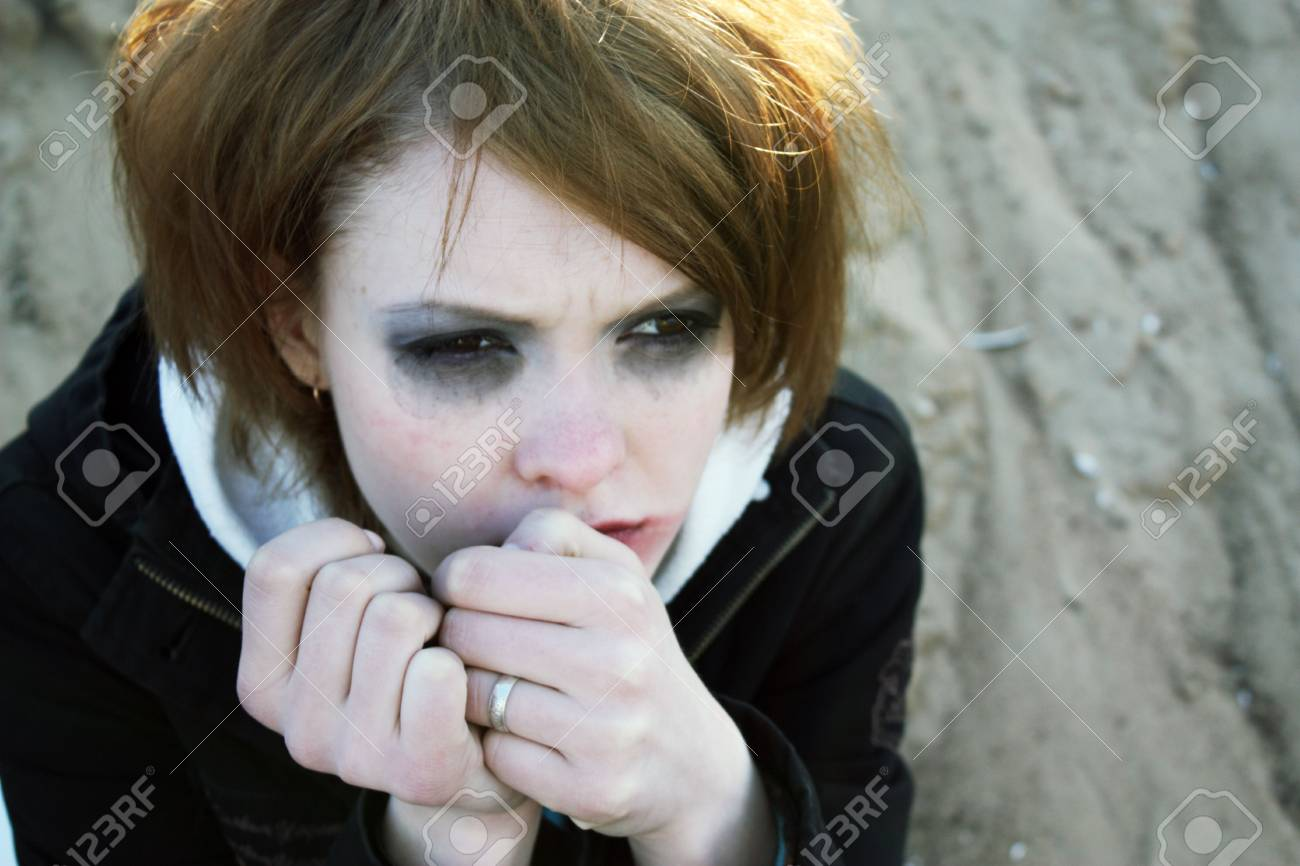 The tear-stained girl with the begun to flow ink looks in the camera. Stock Photo - 4977820