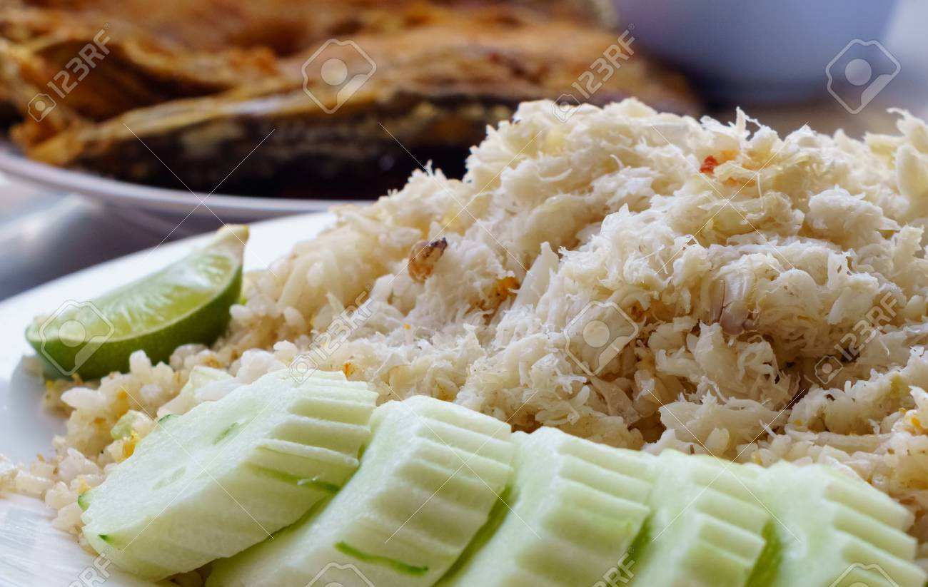 Close up of Fried Rice with Crab Meat with deep fried Snapper