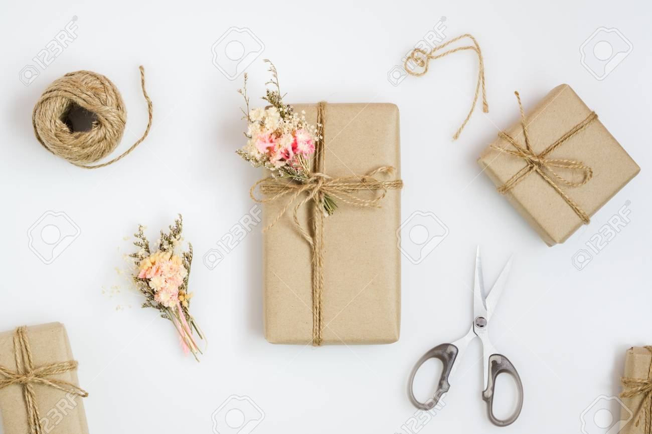 Beautiful small handmade DIY gift box (package) with flowers