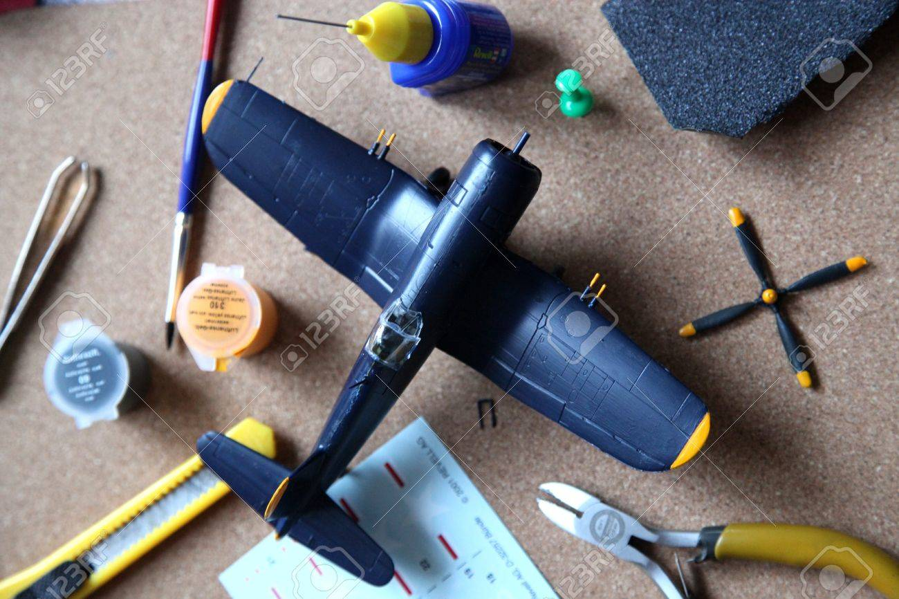A blue plane model set up and tools are on the table Stock Photo - 15853459