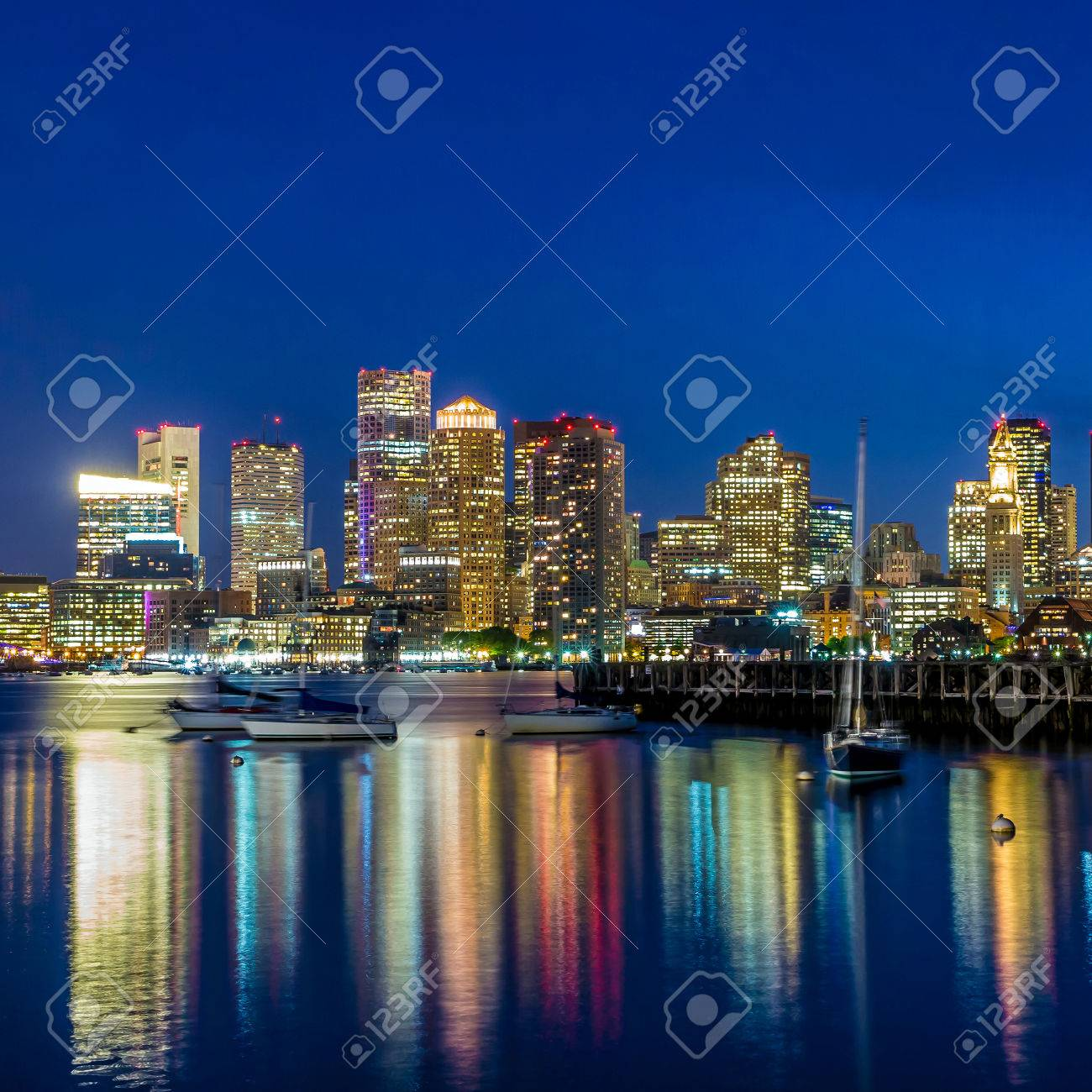 Boston downtown skyline panorama with skyscrapers over water at twilight Stock Photo - 29309289