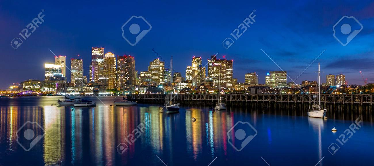 Boston downtown skyline panorama with skyscrapers over water at twilight Stock Photo - 29309295