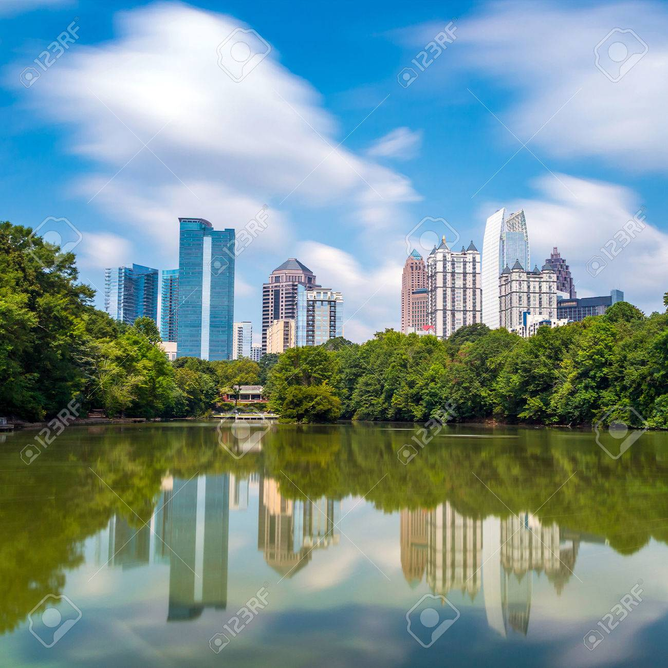 Skyline and reflections of midtown Atlanta, Georgia in Lake Meer from Piedmont Park. Stock Photo - 30728785
