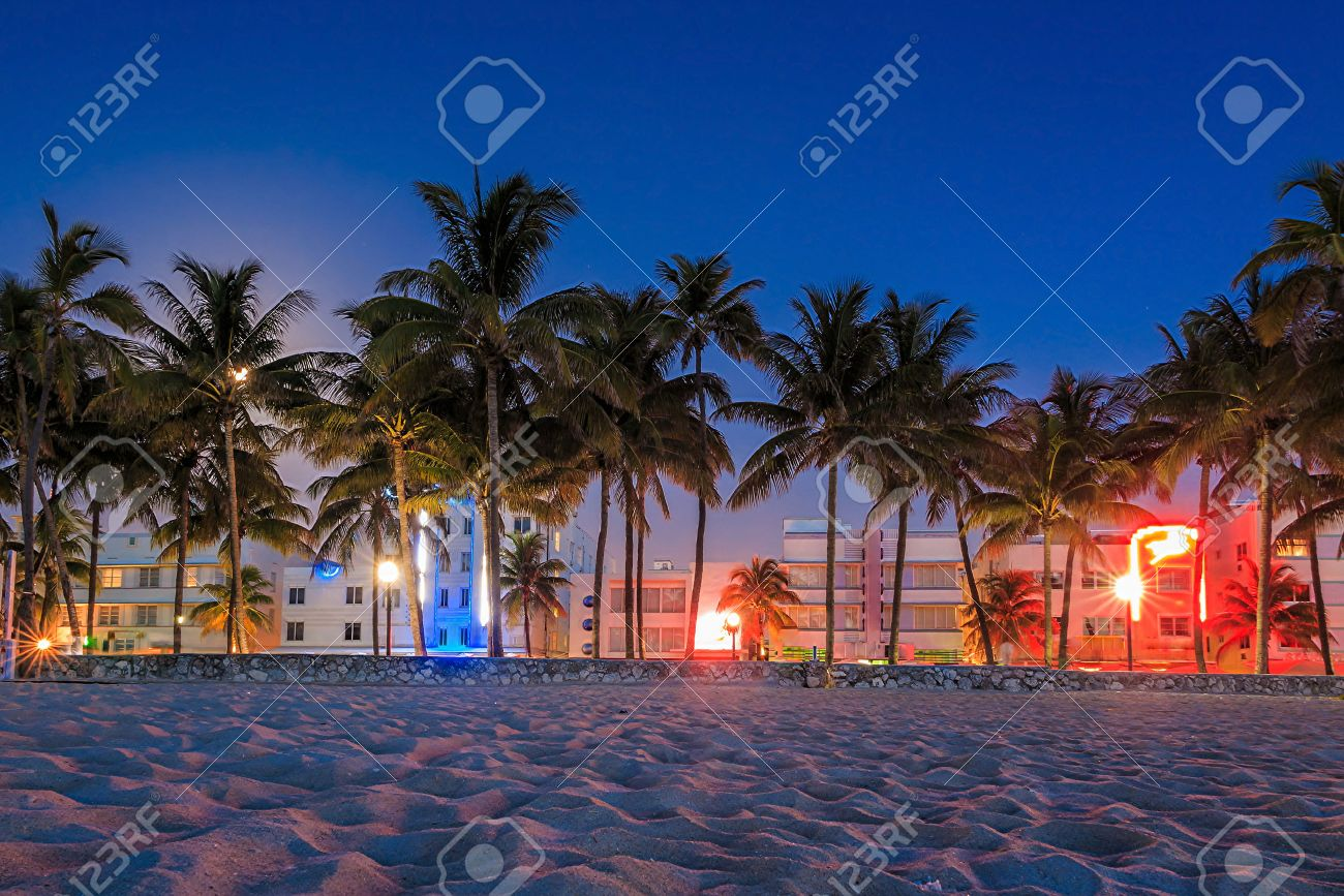Miami Beach, Florida hotels and restaurants at twilight on Ocean Drive, world famous destination for it's nightlife Stock Photo - 30726500