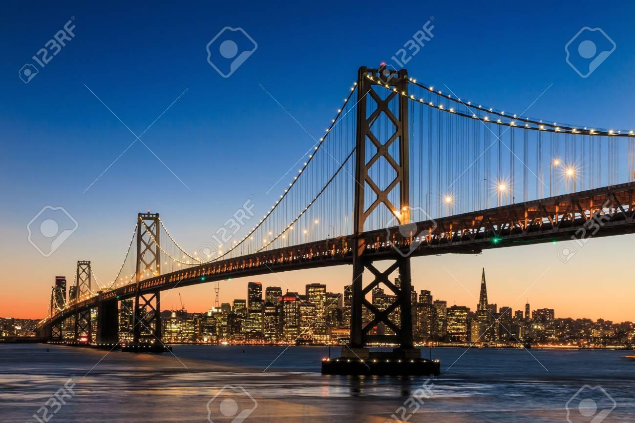 San Francisco skyline and Bay Bridge at sunset, California USA Stock Photo - 38929733