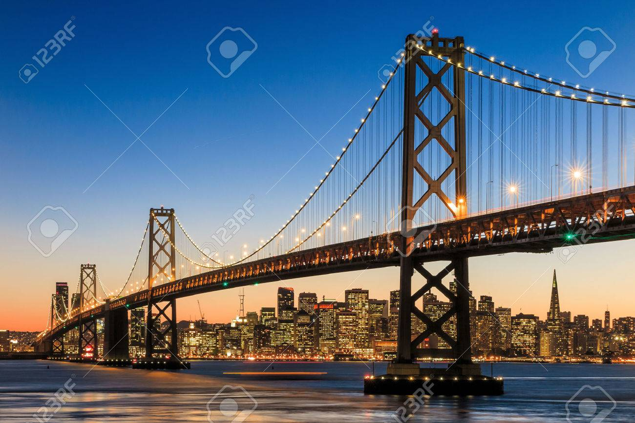 San Francisco skyline and Bay Bridge at sunset, California USA Stock Photo - 38929735