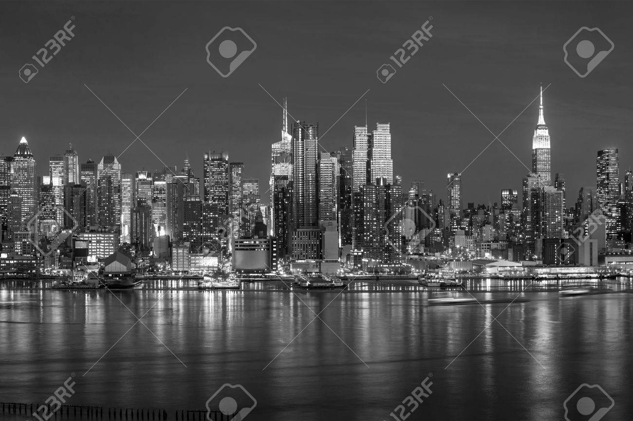 New York City with skyscrapers illuminated over Hudson River panorama in black and white Stock Photo - 39717508
