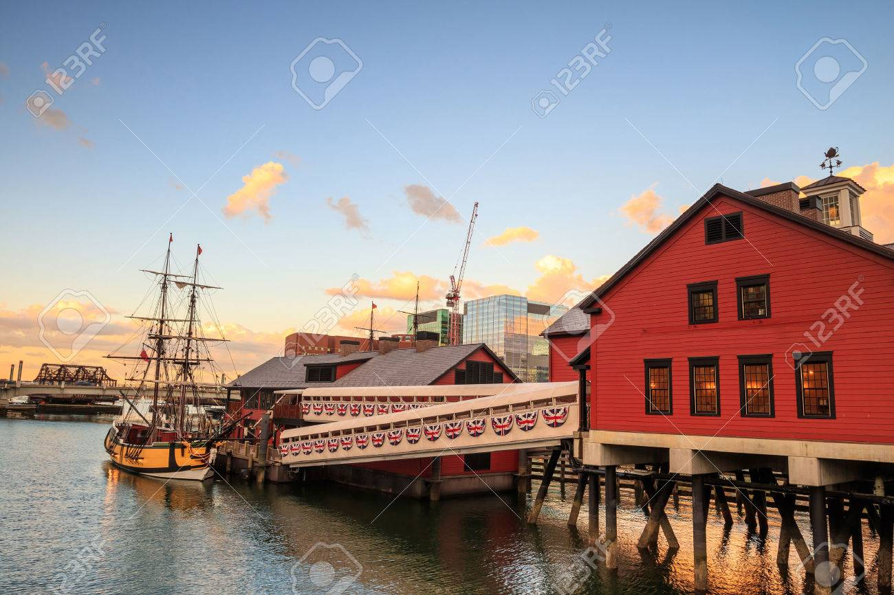Boston Harbor and Financial District at sunset and Tea Party Ships & Museum in Boston, Massachusetts. Stock Photo - 46989427