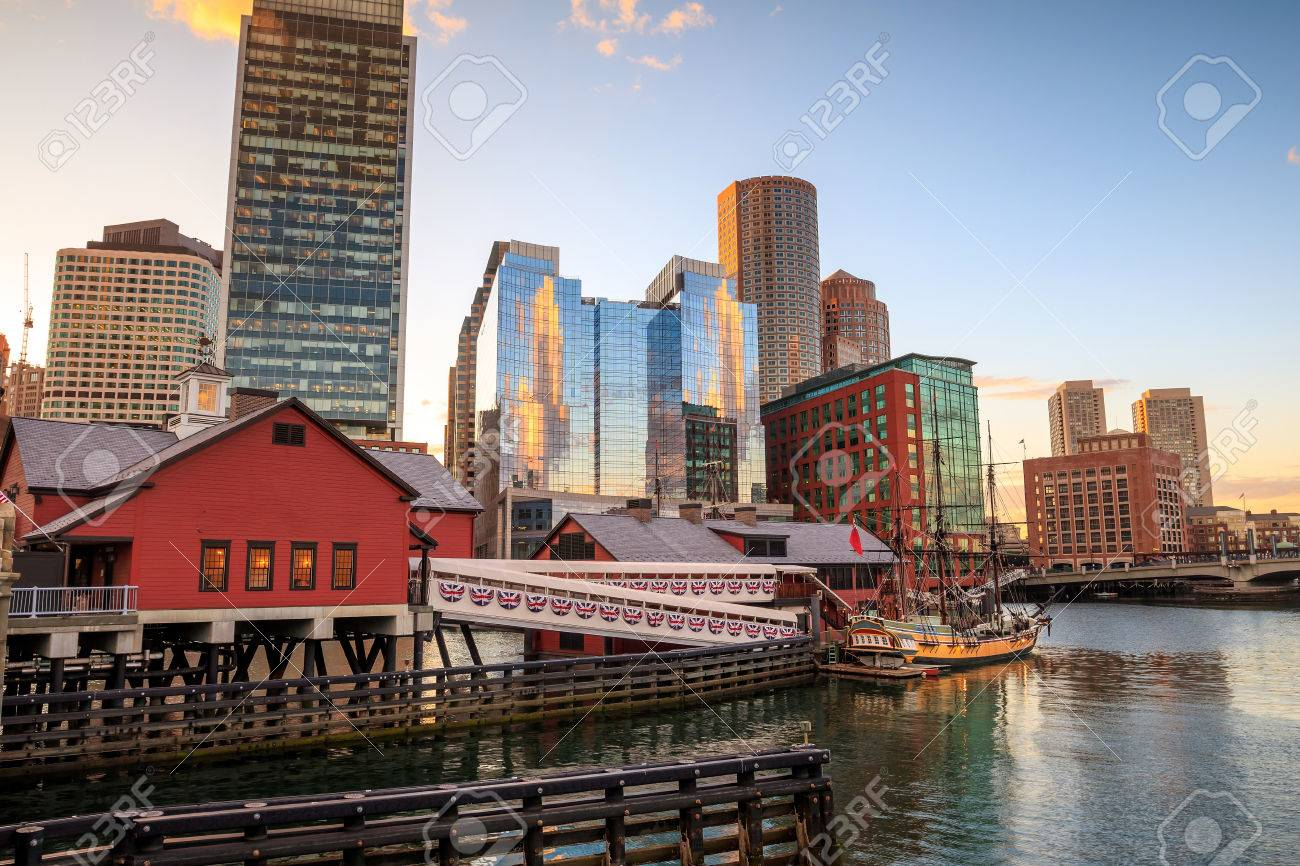 Boston Harbor and Financial District at sunset and Tea Party Ships & Museum in Boston, Massachusetts. Stock Photo - 46894316