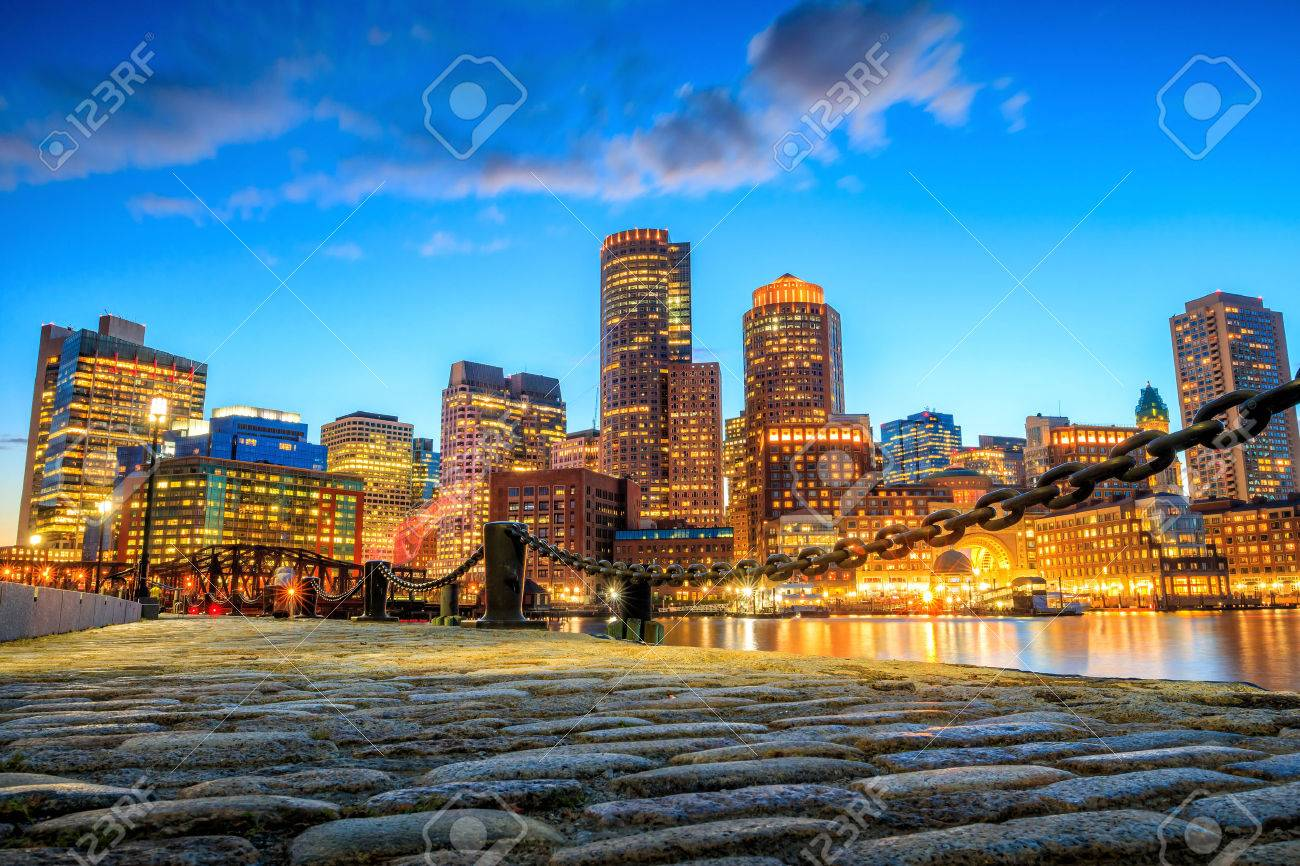 Boston Harbor and Financial District at twilight, Massachusetts. Stock Photo - 46989643