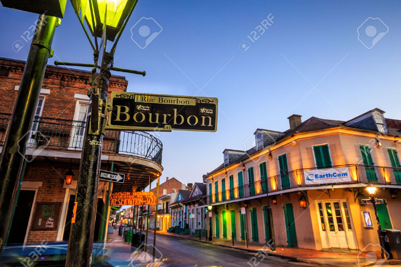 NEW ORLEANS, LOUISIANA - AUGUST 25: Bourbon Street sign with pubs and bars and neon lights  in the French Quarter, New Orleans on August 25, 2015. Stock Photo - 50624581