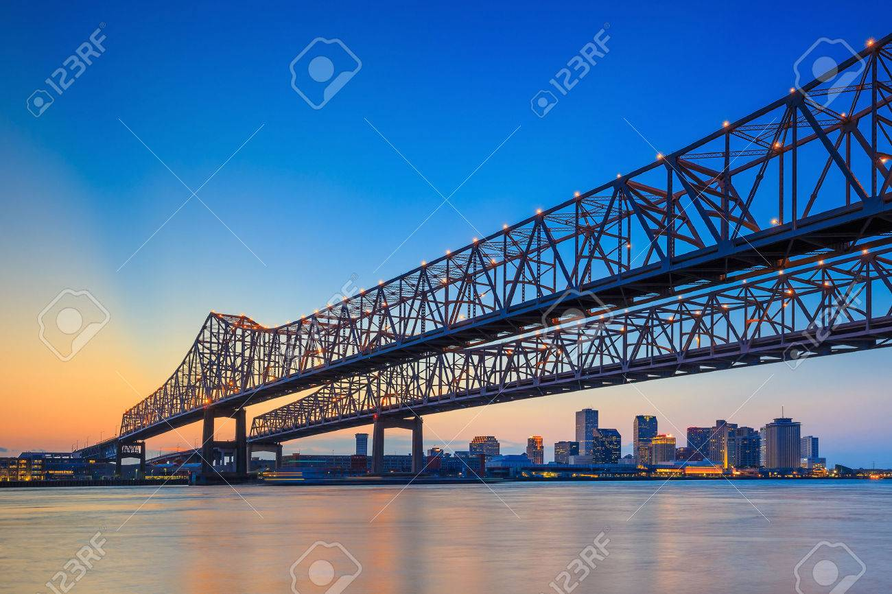 The Crescent City Connection Bridge on the Mississippi river and downtown New Orleans Louisiana - 50671277