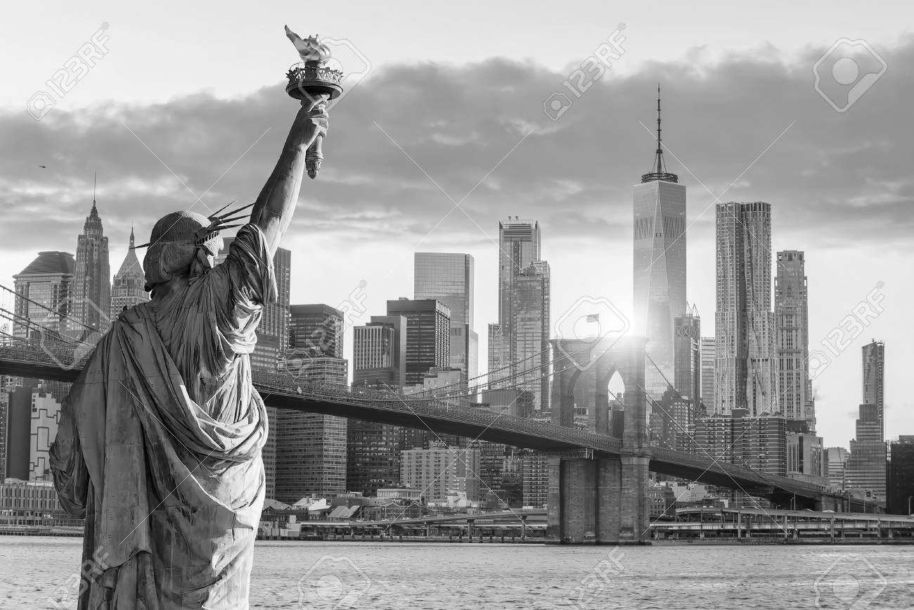 Statue liberty and new york city skyline in black and white in united states stock