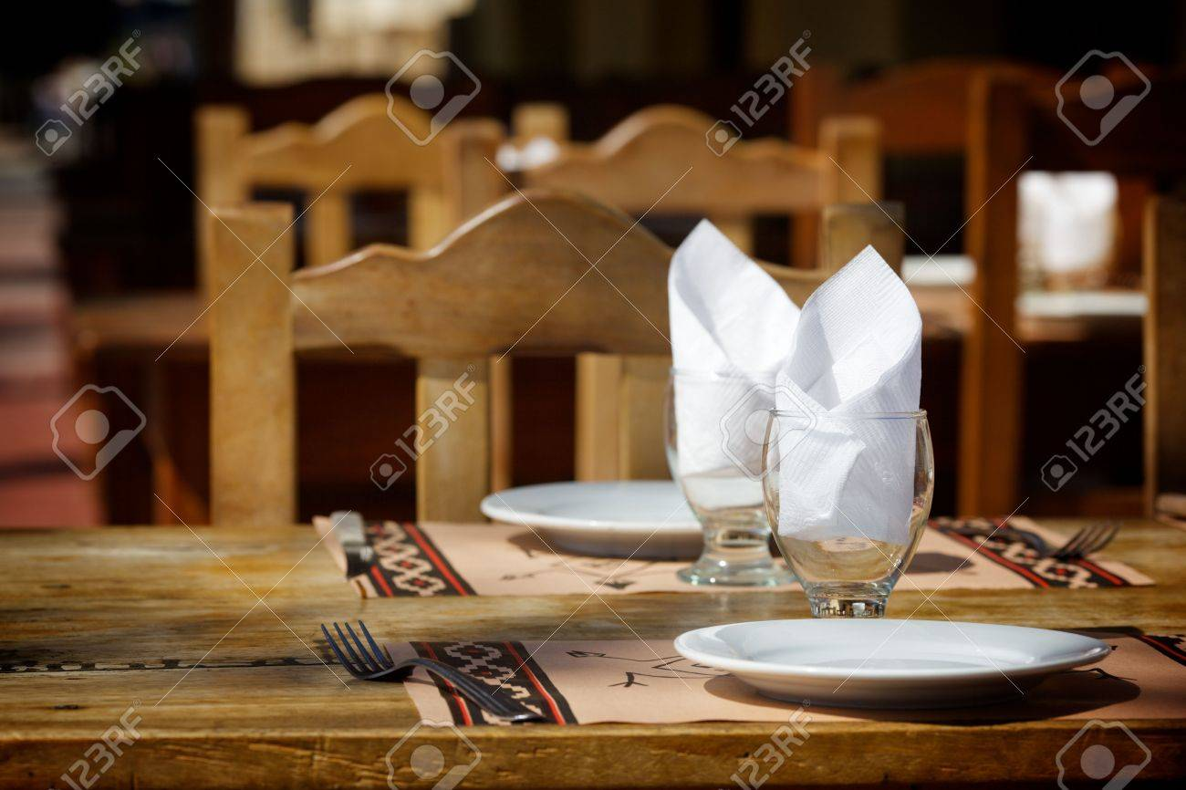 Restaurant table setting for two - Urban Settings Two Empty White Plates Two Glasses With Napkins Standing On A Wooden