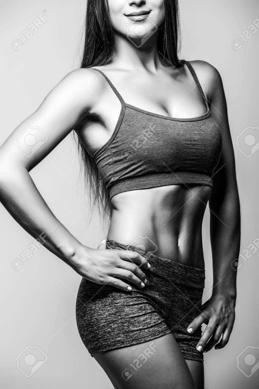 Attractive fitness woman trained female body black and white